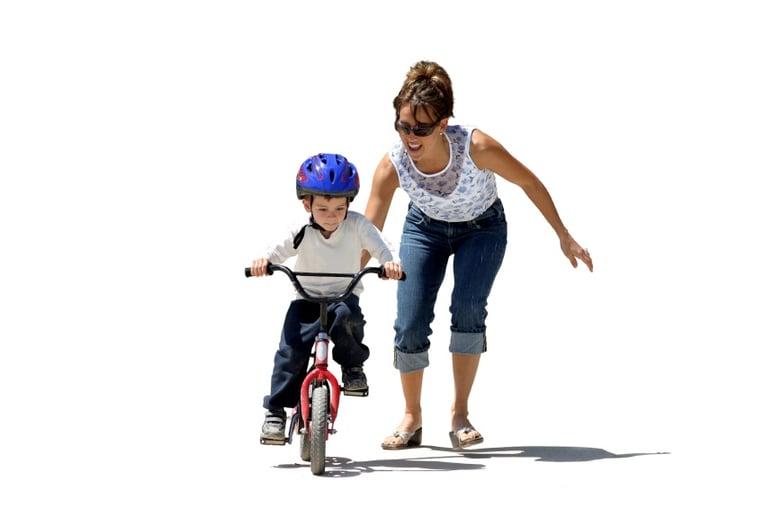 Child Learning to Ride Bike | Development Milestone